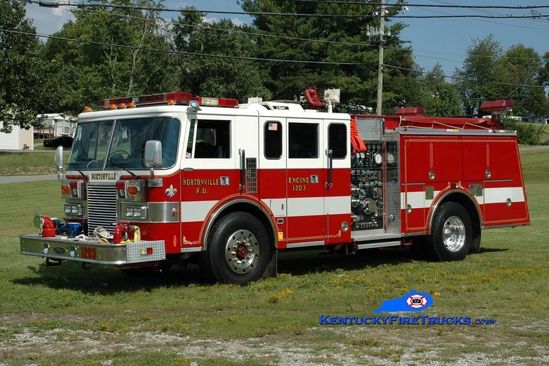 <center> Nortonville  Engine 1203  <br> x-Bethpage, NY  <br> 1991 Pierce Lance  1500/500 <br> Greg Stapleton photo </center>