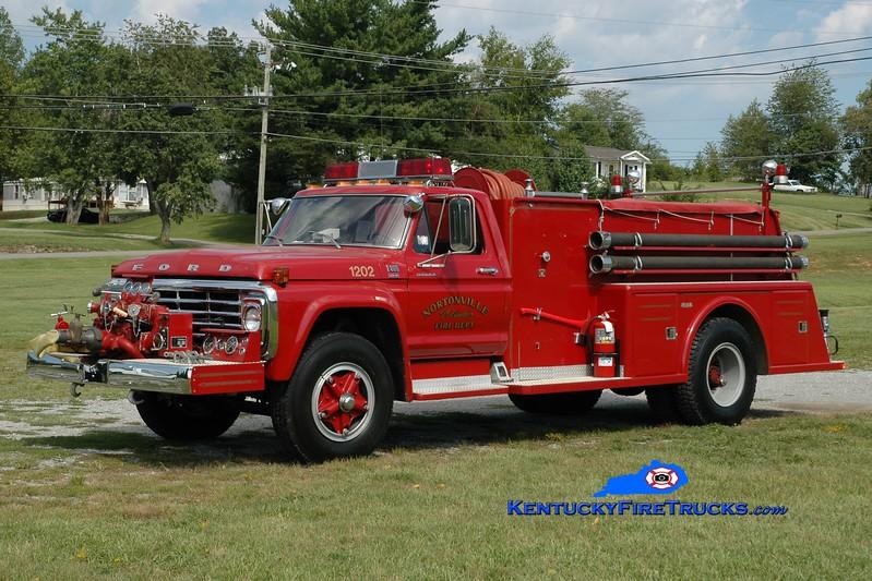 <center> RETIRED <br> Nortonville Engine 1202 <br> 1979 Ford F-800/Towers 750/750 <br> Greg Stapleton photo </center>