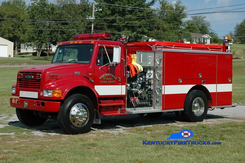 <center> Nortonville  Engine 1200 <br> 2000 International 4900/Pierce 1250/1000 <br> Greg Stapleton photo </center>