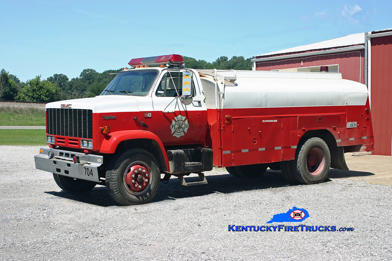 <center> RETIRED <br> South Hopkins  Tanker 704 <br> x-Fuel Truck <br> 1985 GMC TopKick/Brownie 0/2000 <br> Kent Parrish photo </center>