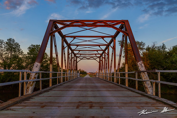 Truss bridge over the Skunk River at sunset on an early fall evening