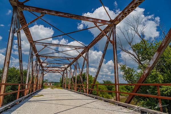 An abandoned truss lays peacefully below the summer sun