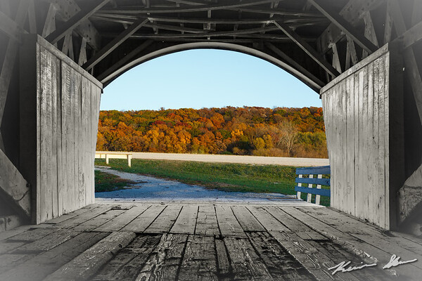 Fall colors glow at sunset through the Hogback covered bridge