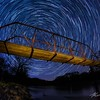 Stars dance around the Wagon Wheel bridge on a spring evening