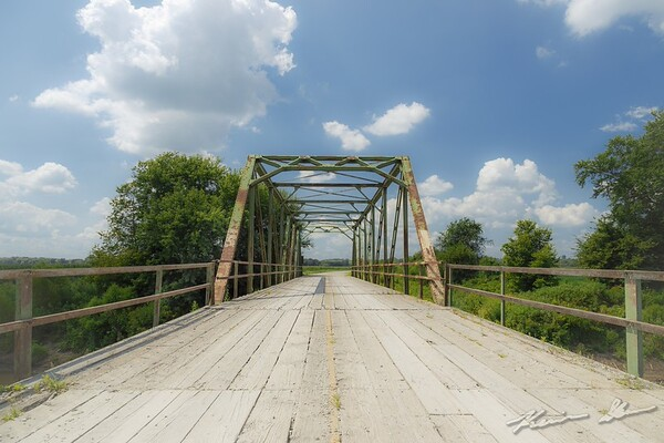 A vintage 1920 truss stands quietly over the Middle Nodaway River