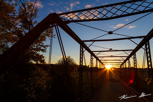 The Mosquito Creek truss bridge in the fading afternoon light at sunset