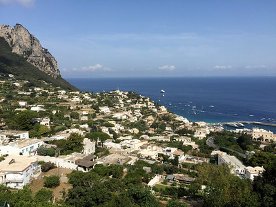 Looking north from the town of Capri over the Bay of Naples with the road to AnaCapri on the left side. The Sea Dream I is anchored in the distance.