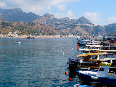 Sailing south, we arrive at the port town of Giardini Naxos on the southern side of Sicily. The town of Taormina (our destination) is on the mountainside in the background.