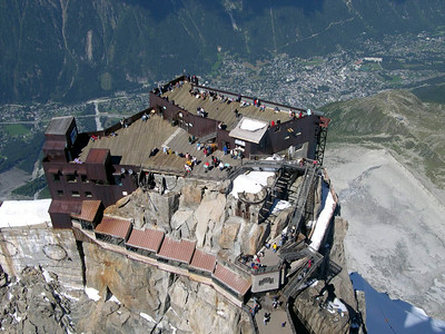 Looking down on the cable relay station at Augille du Midi (that is Chamonix, France in the background.)