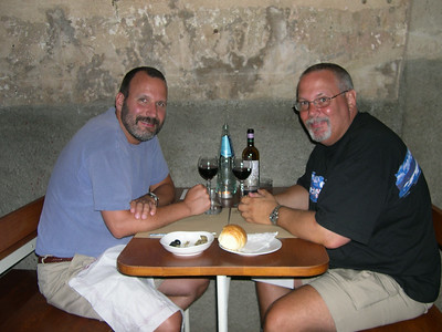 Joe (left) and Ed (right) relaxing after a long day with a bottle of wine before dinner in Alghero, Sardinia.