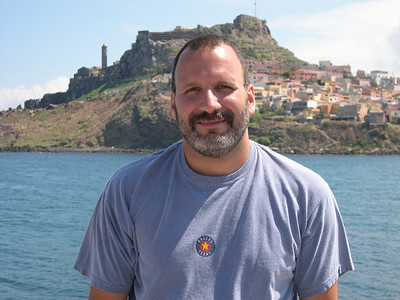 Joe with the town of Castelsardo in the background. We were driving the northern coastal highway between Porto Torres and the islands of La Maddalena.