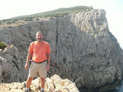 Joe on the edge of the oceanside cliff atop Capo Caccia. As elsewhere in Italy, there were no handrails. Yikes!