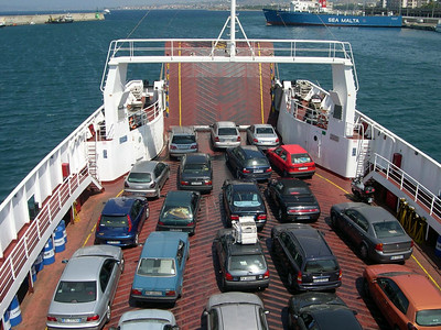 Our trusted Opal Astra autonoleggio, front row on the left. We are leaving the port of Reggio di Calabria, making the short cross over to Sicilia.