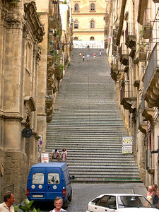 The centerpiece of Caltagirone is the 250  stairs of La Scala di Santa Maria which connect the old city with the new city. Each stair has been designed with a unique tile pattern -- no two of them are alike.