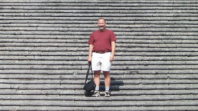 Joe, standing on the long stairs that lead up to the Duomo in Amalfi.