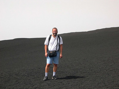 Here is Joe, standing on one of Etna's slopes. We are mostly above the clouds at this point, which accounts for the lack of any scenery behind him.