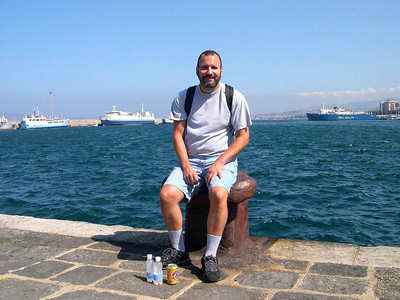 Our latest trip begins in the port city of Reggio di Calabria where we caught a ferry to take us to Sicilia. It's a relatively short ride across the Straits of Messina, less than an hour. Here is Joe waiting at the docks.