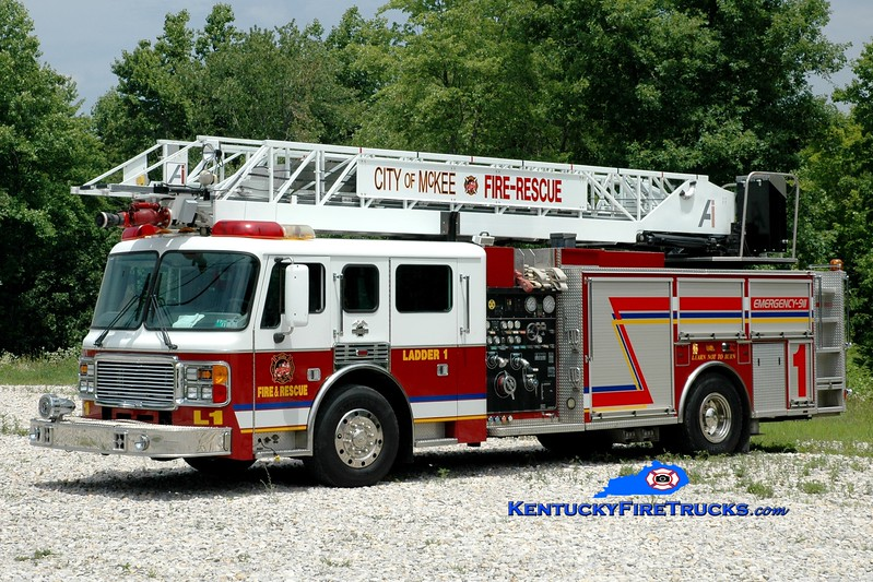 <center> McKee  Ladder 1  <br> x-Midwest City, OK <br> 1999 American LaFrance Eagle/Aerial Innovations 1500/500/75' <br> Greg Stapleton photo </center>