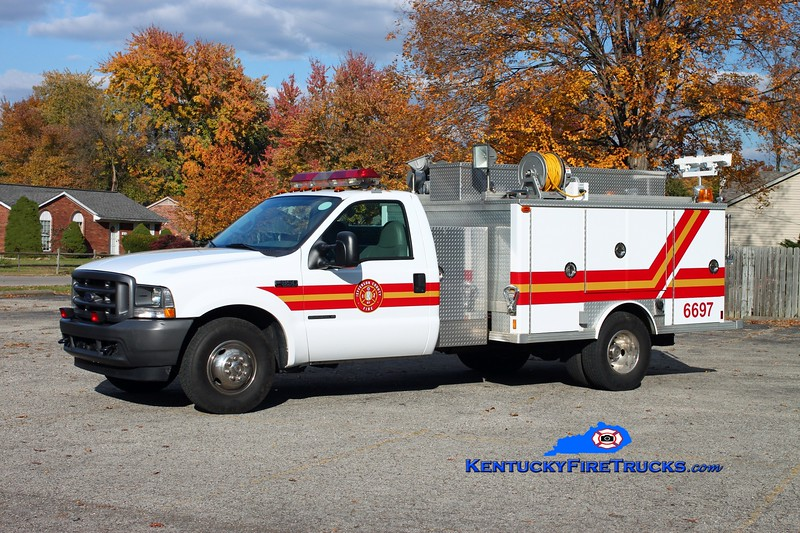 <center> Jefferson County Fire Service  Unit 6697 <br> x-Jefferson County EMS; body x-South Dixie, KY <br> 2001 Ford F-350/1977 E-One  <br> Kent Parrish photo <center>