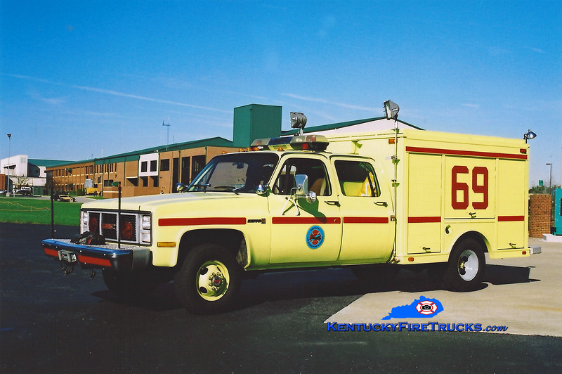 <center> RETIRED <br> Kentucky Air National Guard  Rescue 69 <br> 1990 GMC 3500 4x4/Landoll P-10 <br> Kent Parrish photo </center>
