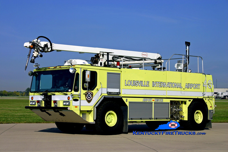 <center> RETIRED <BR> Louisville International Airport  Rescue 48 <br> 1999 E-One Titan 1500/2000/200/52' Snozzle <br> Kent Parrish photo </center>