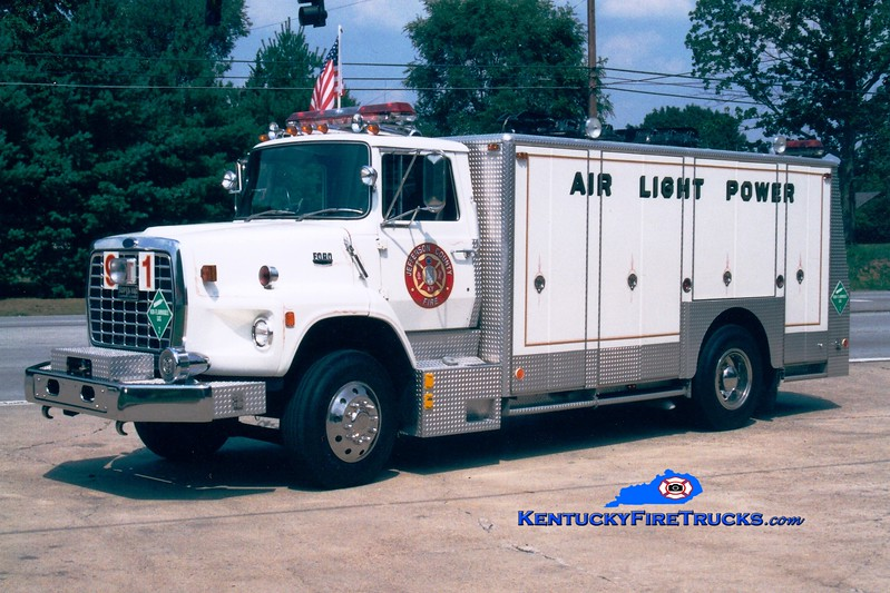 <center> RETIRED <br> McMahan  Utility 5591 <br> 1987 Ford L8000/Super-Vac  <br> Greg Stapleton photo <center> </center></center>
