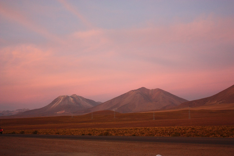 Sunset at the Collahuasi mine site.<br /> Altitude 4300m.<br /> The moutain on the left is an active volcano.<br /> These are actual colors, not enhanced by PS or filters.