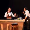 Doctor Dulcamara (Kian Freitas) and Nemorino (Joshua Collier)