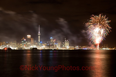 Auckland City with some fireworks being let off in the harbour.