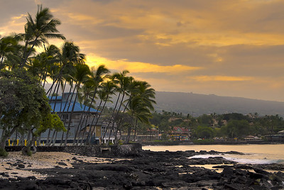 Shot at sunrise in Kailua-Kona on the lava sea-bench over looking the old Chart House into the heart of town. This is an HDR image comprised of five bracketed exposures merged (tone-mapped) to create what my eyes were seeing but the camera could not capture in a single image...