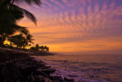 This is shot was taken behind Hulihe'e Palace in Kailua-Kona. A storm front was moving in and the high cirrus clouds were lit-up by the sunrise over Hualalai volcano. I was standing on slippery rocks with my tripod and had to dodge waves as I attempted to set-up the shot...