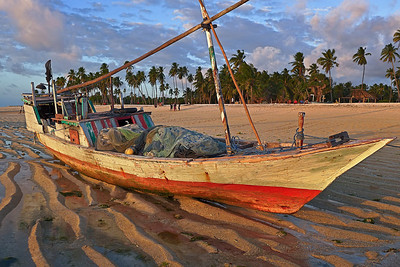 Fishing boat at low tide. Nembrala, Rote Island, Indonesia.