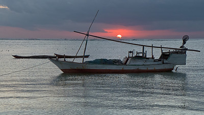 Fishing boat and sunset. Rote Island, Indonesia.