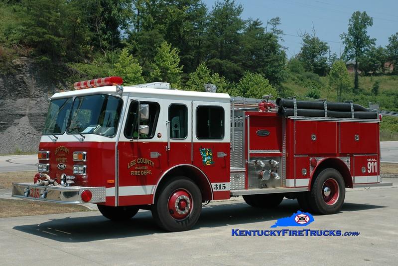 <center> RETIRED <br> Lee County  Engine 315  <br> 1990 E-One Protector 1250/750 <br> Greg Stapleton photo <br> </center>