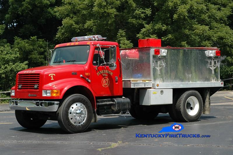 <center> RETIRED <br> Firebrick  Tanker 1 <br> x-Garrison, KY <br> 1999 International 4900/Local 250/1800 <br> Greg Stapleton photo </center>
