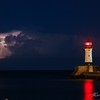 Lightning erupts from a thunderstorm far out over Lake Superior