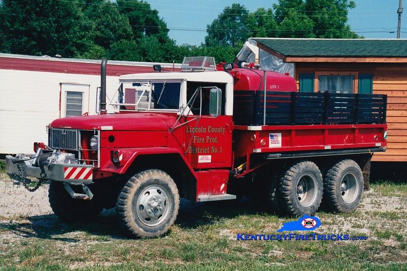 <center> RETIRED <br> Lincoln County Brush 1  <br> 1968 Kaiser M35 6x6/FD 250/600 <br> Greg Stapleton photo <br> </center>