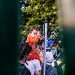 A small child looks back through two fences as his family waits to enter Hungary on September 14, 2015, the last day before the borders were sealed.