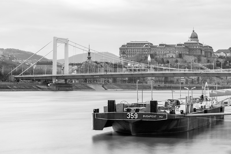 A barge stands moored on Budapest's left bank, just downstream from the Erzsébet bridge.