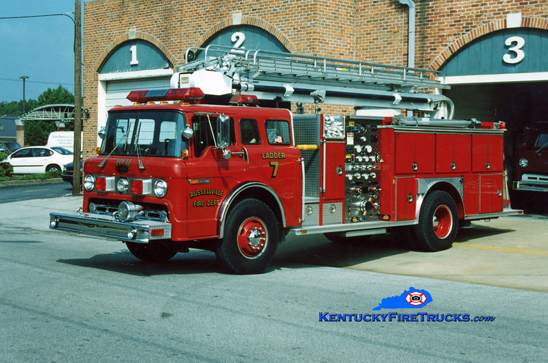 <center> Reassigned as Engine 7 <br> Russellville  Ladder 7 <br> 1990 Ford C-8000/E-One 1250/500/50' Stratospear <br> Kent Parrish photo </center>