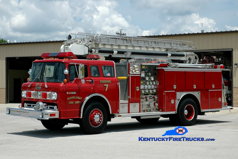 <center> Russellville  Engine 7 <br> 1990 Ford C-8000/E-One 1250/500/50' Stratospear <br> Greg Stapleton photo </center>