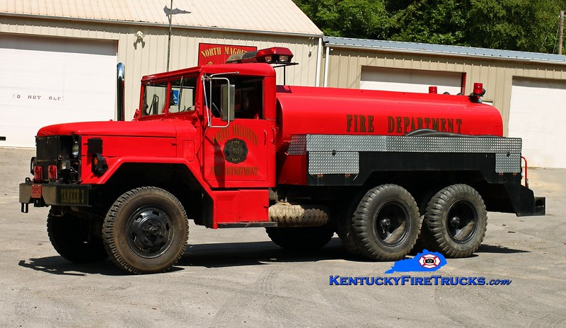 <center> North Magoffin  Tanker 3  <br> x-Forestry <br> 1971 AM General M35A2/Local 250/1200 <br> Kent Parrish photo </center>