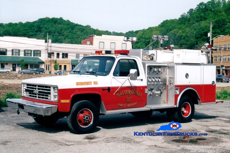 <center> RETIRED <br> Salyersville  Rescue 1  <br> 1987 Chevy 4x4/Word Wide Equipment 450/250 <br> Greg Stapleton photo </center>