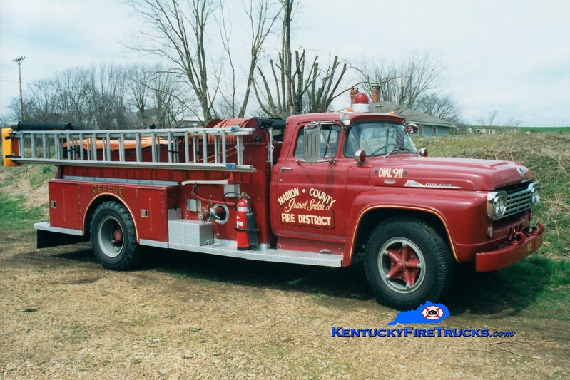 <center> RETIRED <BR> Gravel Switch Engine 103  <br> x-Raywick, KY <br> 1959 Ford F/American LaFrance 500/500  <br> Greg Stapleton photo </center>