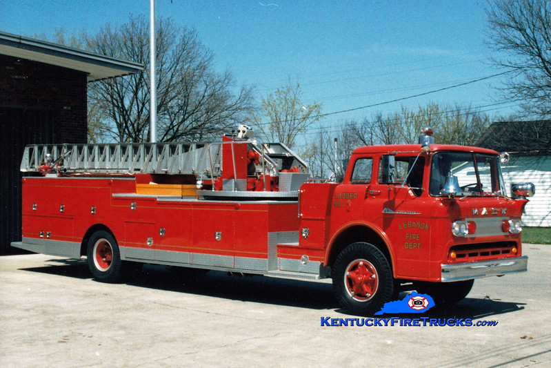 <center> RETIRED <br> Lebanon, KY  Ladder 1 <br> x-Pleasure Ridge Park, KY <br> 1959 Ford C/Pirsch 750/200/75'  <br> *NOT a Mack...Mack adnornments added <br> Greg Stapleton photo </center>