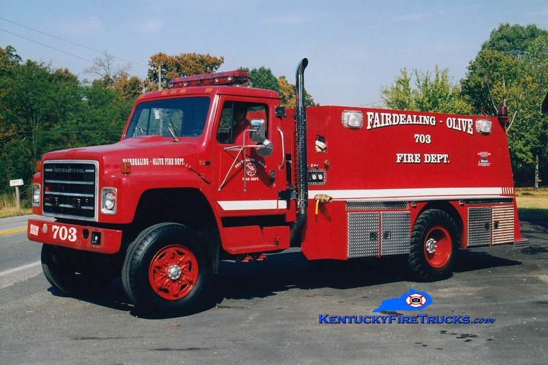 <center> RETIRED <br> Fairdealing-Olive  Tanker 703 <br> 1987 International/Local 250/2000 <br> Greg Stapleton <br> </center>