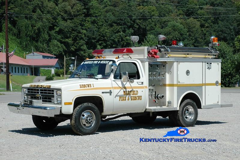 <center> RETIRED <br> Warfield  Rescue 1 <br> x-W.R. Castle, KY <br> 1987 Chevy 4x4/Allegheny 250/250 <br> Greg Stapleton photo </center>