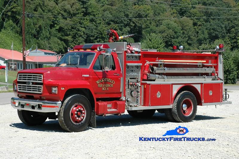 <center> RETIRED <br> Warfield  Engine 6 <br> 1987 Ford F-800/E-One 1000/1250 <br> Greg Stapleton photo </center>