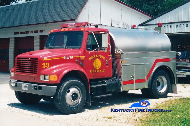 RETIRED<br /> North McCreary  Tanker 23<br /> 1995 International 4900/2003 Bluegrass 0/1800<br /> Greg Stapleton photo