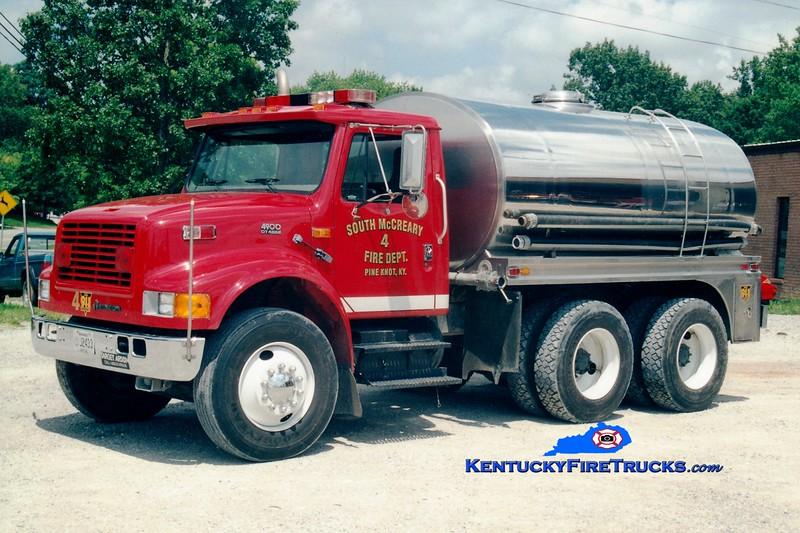 <center> South McCreary  Tanker 44 <br> 1997 International 4900/Bluegrass 250/2500 <br> Greg Stapleton photo </center>